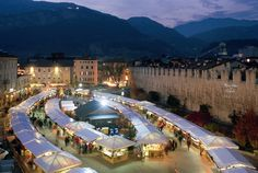 Mercatino di natale – Trentino.  Mountain Christmas markets in Italy can be warm ways to celebrate the holiday season