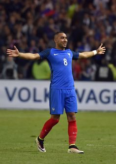 France's forward Dimitri Payet celebrates after scoring a goal during the International friendly football match between France and Cameroon at the Beaujoire stadium, in Nantes, western France, on May 30, 2016 as part of the French team's preparation for the upcoming Euro 2016 European football championships. / AFP / LOIC VENANCE