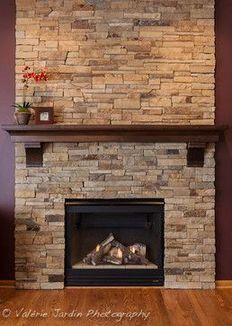 I love this stacked stone fireplace. I think the brown in the stone would look pretty as our corner fireplace in the living room. Wouldn't go all the way to the ceiling, we'd stop at the mantle, but wrap from wall to wall instead of just the front wall. Farmhouse Fireplace, Home Fireplace, Fireplace Remodel, Living Room With Fireplace, Fireplace Surrounds, Fireplace Design, Fireplace Ideas, Fireplace Stone, Fireplace Hearth