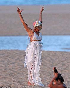 Stretching it out! Bey wore a white maxi dress with cut-outs at the waist along with a colourful headscarf
