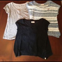 Bundle 3 Hollister Shirts Three Hollister shirts. Striped is sweater like material, but isn't heavy material. Gray is cute and flowy. Navy blue is flowy with floral lace on the front. All are in perfect condition and could fit S/M. ✨Let me know if you are interested in purchasing shirts separately!✨ Hollister Tops Tees - Short Sleeve