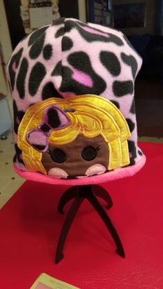 Lalaloopsy applique on a fleece hat,  reversible to hot pink hat
