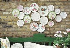 Love plate collections. Love that this one is on a brick wall (I assume outside!).