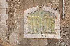 wood windows with stone facade | ... of an ancient stone wall in France with a traditional shuttered window