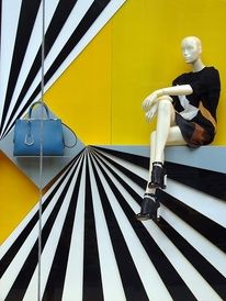 Fendi, Window Display: great use of contrast and linear eye paths... If the grey shelf holding the bag had been painted to match the yellow background