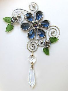 forget-me-knot suncatcher with vintage glass, lead crystal prism, and wire scroll work....JasGlassArt