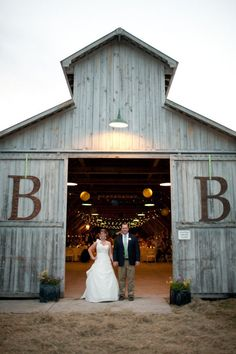 barn Reception with hanging monogram - Need to figure out how I could do this on the front of the shed....