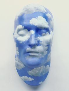 """""""The Future of Statues,"""" by René Magritte, Made from a commercial plaster reproduction of the death mask of French Emperor Napoleon Bonaparte. Magritte painted at least five of these casts, each with sky and clouds. Rene Magritte, Richard Serra, Statues, Rotterdam, Guernica, Théo Van Rysselberghe, James Ensor, Sculpture Art, Sculptures"""