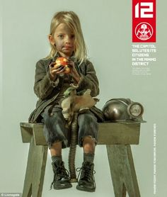 A young child miner representing District 12 in Panem was shown in a new poster released for the upcoming The Hunger Games: Mockingjay - Part 1
