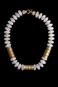 White Matte Large Oval Rock Crystal Beads and 3 Chavin Gold Necklace. South Coast, Peru. 1000-500 BC