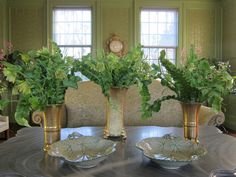 Hellebore blooms and unusual fern fronds look fantastic in these gilded vases.