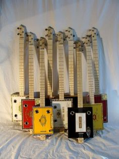 Look at these beauties. We sell lots of parts to cigar box guitar builders… Guitar Shop, Music Guitar, Playing Guitar, Making Musical Instruments, Homemade Instruments, Ukulele, Cigar Box Guitar Plans, Cigar Box Crafts, Music Machine