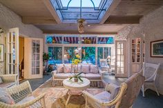 The sunroom opens onto the pool and terrace areas.