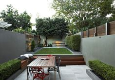 Outdoor green space garden modern design. Wood, natural elements.