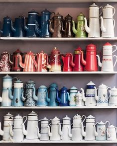 How To Fake A Well Traveled Home: start a collection Nothing makes a 'curated over time' statement like a well-organized collection on display. We're loving these chic vintage French pitchers, but remember that not every collection will inspire a global feel. Consider vintage items, artwork, or something with international appeal, and remember to display with care and order. The color coding here is the perfect example.