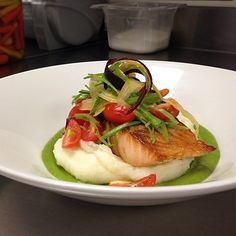 Pan seared salmon with mashed potatoes, celery purée and seasonal vegetables
