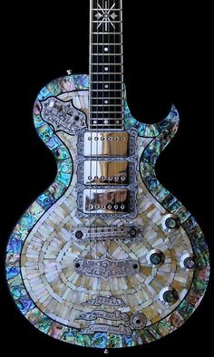 "electricized:  Last one: Teye La Perla ""A"". Check out the engraving work on the headstock:"