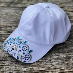 White baseball cap / hat hand painted and decorated with   Etsy White Baseball Cap, Baseball Hats, White Caps, Original Gifts, Cockatoo, Kissing, Little Gifts, Caps Hats, Rhinestones