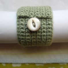 Button napkin ring in pistachio alpaca silk with vintage mother of pearl fish eye button.