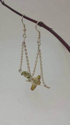 Bird on a wire. Little bird beads from South by EJGjewelry Plant Hanger, South America, Eye Candy, Handmade Jewelry, Super Cute, Wire, Lovers, Beads, Etsy
