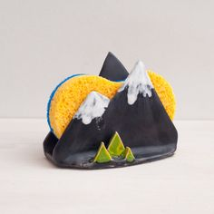 Handmade ceramic sponge holder. I made it manually from ceramics and decorated with glaze.  Do you love the mountains? Yes! This is a small reminder of the nature is a good decoration for your kitchen, as well as a convenient means of storing sponges or napkins.  In stock and ready to ship. We do shipping worldwide.  Approximate measurements: Tall: 9cm \ 3,54 Length: 11,5cm \ 4,52 Width: 5cm \ 1,96  You can see all my sponge holders here: https://www.etsy.com/shop/NCeramic...