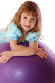 10 ways to use an exercise ball with children:  strengthen, motor planning, body awareness and postural control