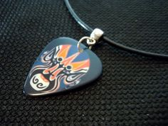 Kabuki Mask Guitar Pick on Black Rolled Leather Cord Necklace by ItsYourPick on Etsy