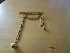 "New Listing Started vintage goldtone 2.5"" bar brooch with dangling chain/balls in good condition £2.15"