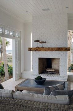 white fireplace with wood mantle - white fireplace . white fireplace with wood mantle . Painted Brick Fireplaces, Paint Fireplace, White Fireplace, Living Room With Fireplace, Fireplace Design, Living Room Decor, Living Rooms, Fireplace Ideas, Fireplace Outdoor