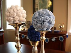 DIY Hanukkah Tissue Kissing Balls on top of silver candlesticks