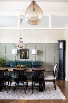 Love the sophisticated, moody look of this dining room!