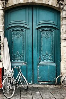 Totally in love with these doors - colour, detail, scale (& the bike!)  via Karyn Marshall