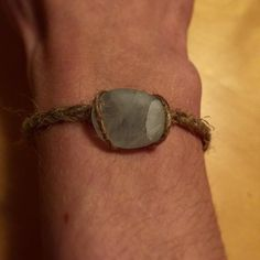 Bracelet made out of natural 2mm rope that I've braided and a sandpolished rock that I found on a beach in Spain