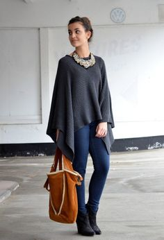 Shop this look on Lookastic: https://lookastic.com/women/looks/poncho-skinny-jeans-wedge-ankle-boots/13995 — White Beaded Necklace — Charcoal Poncho — Navy Skinny Jeans — Black Suede Wedge Ankle Boots — Tobacco Suede Tote Bag