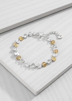 Crystal Link Bracelet | Whether you're a Sterling Silver or a Brass girl, this dainty, mixed-metal Bracelet layers well with any of your Silpada favourites. It features subtle Crystal accents that add just the right amount of sparkle, making it a piece you can wear day or night.  Material: Brass, Sterling Silver, Swarovski™