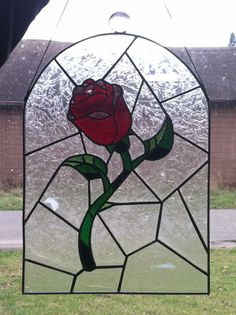 Hey, I found this really awesome Etsy listing at https://www.etsy.com/listing/206210664/beauty-and-the-beast-rose-stained-glass
