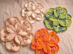 Flower created by crocheting 5 individual motifs, then crocheting them together -- free pattern