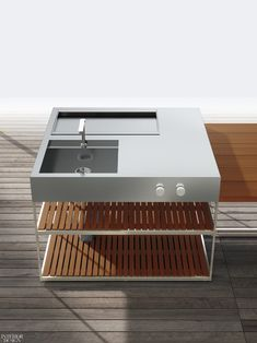 Alessandro Andreucci and Christian Hoisl's AH01 outdoor kitchen with cook and wash stations in satin-finished stainless steel and iroko by Boffi.