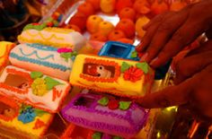 (mexican) sugar coffins---toys to delight the returning spirits of children (nov. 1st) part of the day of the dead festivities or all saints/souls day observed in other countries like italy or spain.