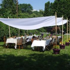Good idea using the potted plants for the base of a diy awning shabby chic canopy for wedding shower solutioingenieria Image collections