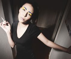 Smoking girl. Model Anja Suder. Photo: Lars Brandt Stisen