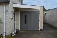 """Openslaande houten garagedeuren model """"Buurse"""" Deurdikte 68mm Dark Red Meranti Links of rechts openslaand (van buiten gezien) Deuren symmetrisch of 1/3-2/3 verdeling Deuren zijn voorzien van een zeer hoogwaardige isolatiekern Rubber tochtkader in zowel de deuren als het kozijn gefreesd In één deur (naar wens de loopdeur of passieve deur) een strook beglazing van 200mm … New Homes, Garages, Outdoor Decor, Decor, Garage, Garage Doors, Home, Doors, Home Decor"""