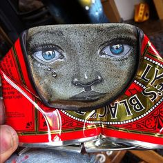 Today's can will comfort you when your days are blue, by My Dog Sighs, via Flickr.    Street artist My Dog Sighs creates gorgeously painted faces on found crushed cans, which he then leaves on the streets in random places for passers-by to take home. It is both a street art installation project and an altruistic gesture dedicated to the cause of free art for everyone.