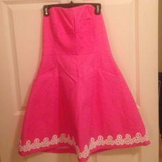 Lilly Pulitzer Pink Strapless Embroidered Dress Only wore this dress one time! It is in perfect condition and I hope a Lilly Pulitzer lover will add this to her closet!! Lilly Pulitzer Dresses
