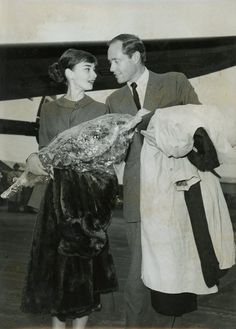 """The actress Audrey Hepburn photographed with her husband Mel Ferrer (actor, dialogue coach and film director) during their arrival at the Los Angeles International Airport from Rome (Italy), after the end of filming their new movie """"War and Peace""""...."""