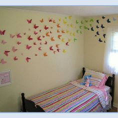 Enter 100+ butterflies hand cut from Martha's templates and stapled to the wall with a standard stapler