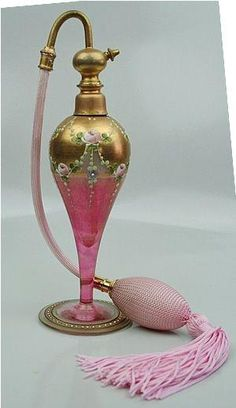 Marcfranc France Perfume Atomizer Hand Painted 1800's  This is a very unique hand painted Marfranc France perfume atomiser from the 1800's. The hand painted detail is just amazing on this piece. The glass is rose colored with gold accents and has a rose floral pattern detail throughout. by gilda