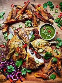 Piri piri chicken with sweet potato wedges. Crisp, spicy roast chicken, served with piri piri sauce, jalapeño salsa and sweet potato wedges – delicious!