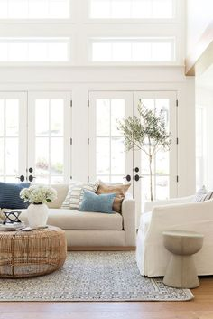bright white cozy living room natural light French doors while sofa white armchair wicker coffee table frenchDecorating bright white cozy living room natural light French doors while sofa white armchair wicker coffee nbsp hellip white Living Room Cozy Living Rooms, My Living Room, Home And Living, Living Room Decor, Small Living, Sitting Rooms, Coastal Living, Barn Living, Coastal Cottage