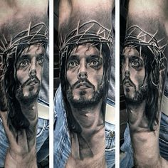 Male Wih Religious Tattoo On Forearms